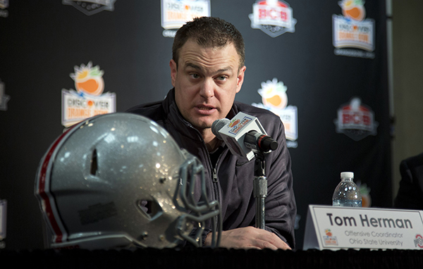 <div class='meta'><div class='origin-logo' data-origin='AP'></div><span class='caption-text' data-credit='AP'>FILE - In this Jan. 3, 2014, file photo, Ohio State offensive coordinator Tom Herman talks to the media during an NCAA college football news conference in Fort Lauderdale, Fla.</span></div>