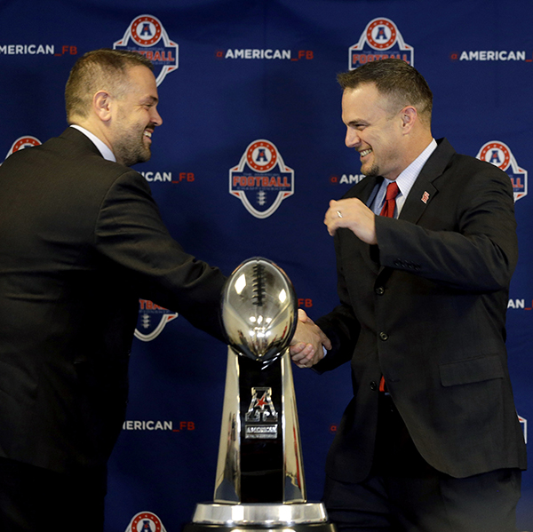 <div class='meta'><div class='origin-logo' data-origin='AP'></div><span class='caption-text' data-credit='AP'>Temple coach Matt Rhule, left, shakes hands with Houston coach Tom Herman during an American Athletic Conference football championship news conference Dec. 4, 2015, in Houston.</span></div>