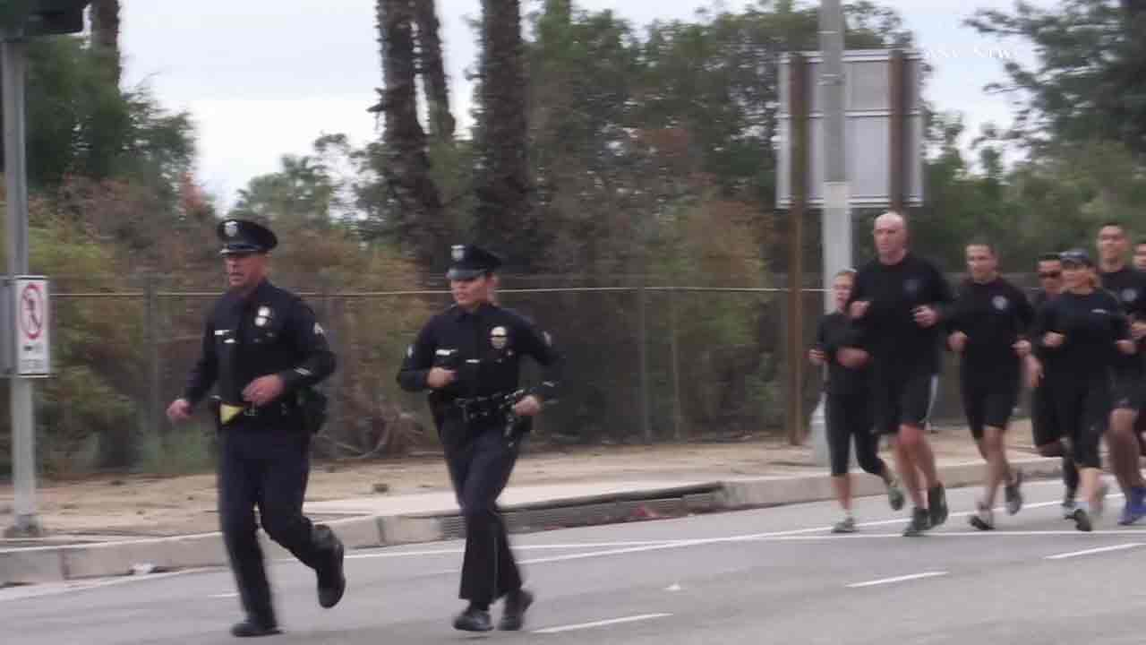 LAPD officers Joe Cirrito and Kristina Tudor start a 400-mile run on Sunday, Nov. 27, 2016, as an effort to raise money for the families of fallen officers.