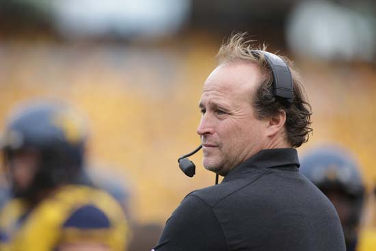 """<div class=""""meta image-caption""""><div class=""""origin-logo origin-image ap""""><span>AP</span></div><span class=""""caption-text"""">FILE - In this Sept. 26, 2015, file photo, West Virginia coach Dana Holgorsen watches his team play Maryland in an NCAA college football game in Morgantown, W.Va. . ((AP Photo/Raymond Thompson, File))</span></div>"""