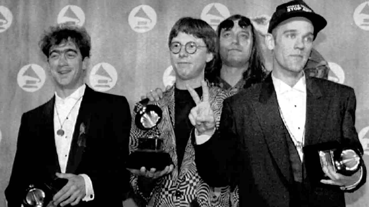The Music group R.E.M. poses with three Grammys they received at the Grammy Awards in New York, Feb. 25, 1992.