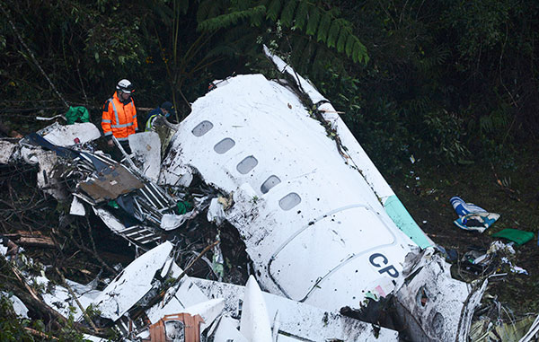 <div class='meta'><div class='origin-logo' data-origin='none'></div><span class='caption-text' data-credit='Luis Benavides/AP Photo'>Rescue workers search on Tuesday, Nov. 29, 2016, at the wreckage site of a chartered airplane that crashed outside Medellin, Colombia.</span></div>
