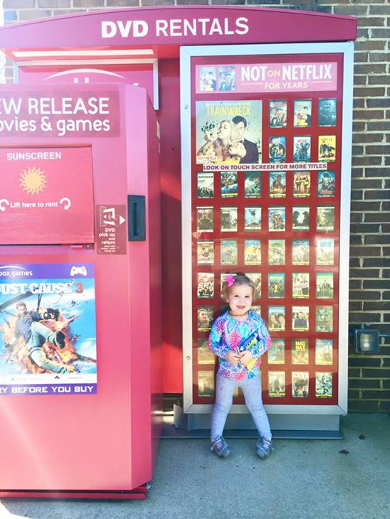 <div class='meta'><div class='origin-logo' data-origin='none'></div><span class='caption-text' data-credit='Molly Stillman/www.stillbeingmolly.com'>Lilly leaving popcorn and money for a rental at a Red Box</span></div>