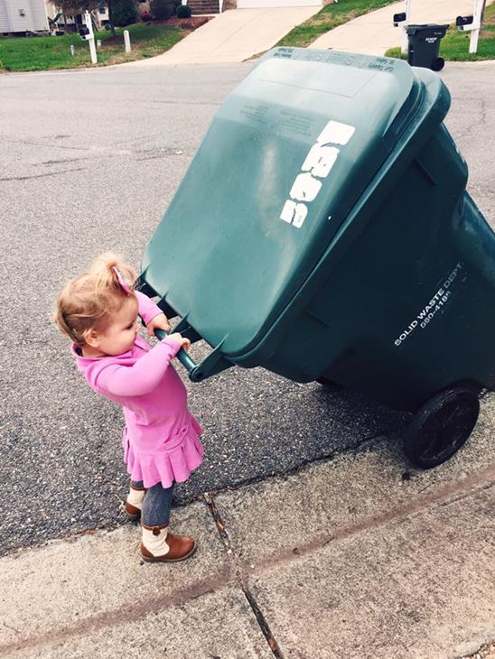 <div class='meta'><div class='origin-logo' data-origin='none'></div><span class='caption-text' data-credit='Molly Stillman/www.stillbeingmolly.com'>Lilly taking her neighbor's trash cans back to the house from the curb on trash day</span></div>