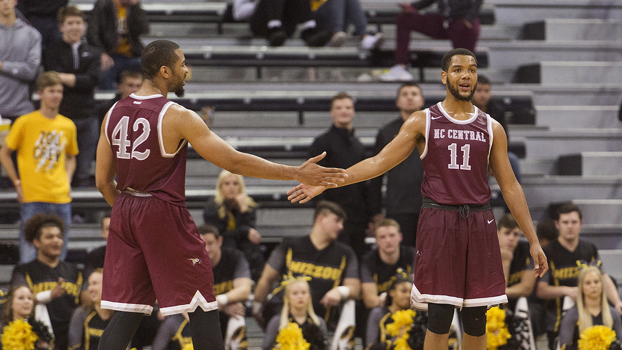 North Carolina Central's Will Ransom, left, congratulates teammate Patrick Cole, right, in the final minutes of the second half of an NCAA college basketball game against Missouri.