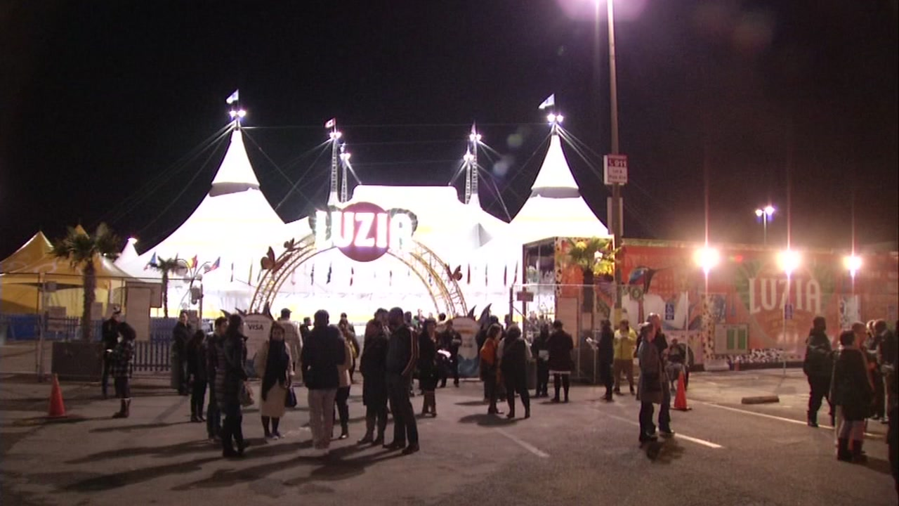Attendants gather outside the Luzia tent in San Francisco after the show was cancelled on Nov. 29, 2016.