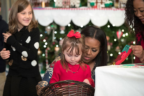 <div class='meta'><div class='origin-logo' data-origin='none'></div><span class='caption-text' data-credit='Andrew Harnik/AP Photo'>First lady Michelle Obama makes holiday crafts with children in the State Dining Room of the White House during a preview of the 2016 holiday decor for military families.</span></div>