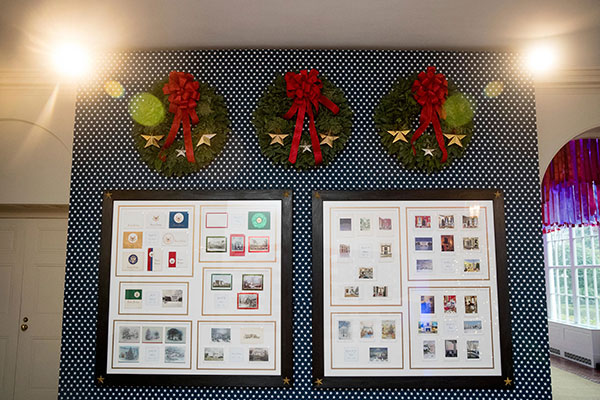 <div class='meta'><div class='origin-logo' data-origin='none'></div><span class='caption-text' data-credit='Andrew Harnik/AP Photo'>Christmas cards from past presidents are displayed in the Booksellers area of the White House during a preview of the 2016 holiday decor, Tuesday, Nov. 29, 2016, in Washington.</span></div>