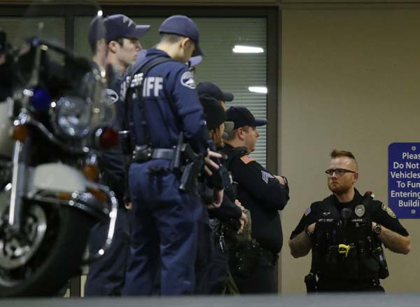 <div class='meta'><div class='origin-logo' data-origin='AP'></div><span class='caption-text' data-credit='AP Photo/Ted S. Warren'>Law enforcement officers gather at Tacoma General Hospital, where a Tacoma Police officer was taken after being shot</span></div>