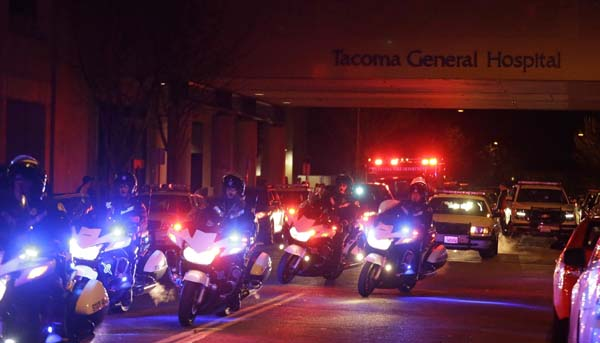 <div class='meta'><div class='origin-logo' data-origin='AP'></div><span class='caption-text' data-credit='AP'>Motorcycle law enforcement officers lead a procession away from Tacoma General Hospital</span></div>