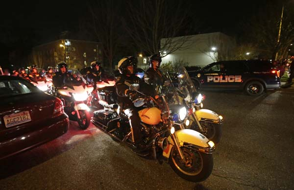 <div class='meta'><div class='origin-logo' data-origin='AP'></div><span class='caption-text' data-credit='AP Photo/Ted S. Warren'>Motorcycle law enforcement officers prepare to lead a procession away from Tacoma General Hospital</span></div>