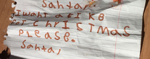 A letter written by the little boy who died was found in the rubble of his family's apartment.