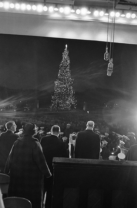 <div class='meta'><div class='origin-logo' data-origin='none'></div><span class='caption-text' data-credit='AP Photo'>President Eisenhower, right, faces the National Christmas Tree as he lighted it in Washington formally opening the annual Christmas Pageant of Peace on Dec. 23, 1960.</span></div>