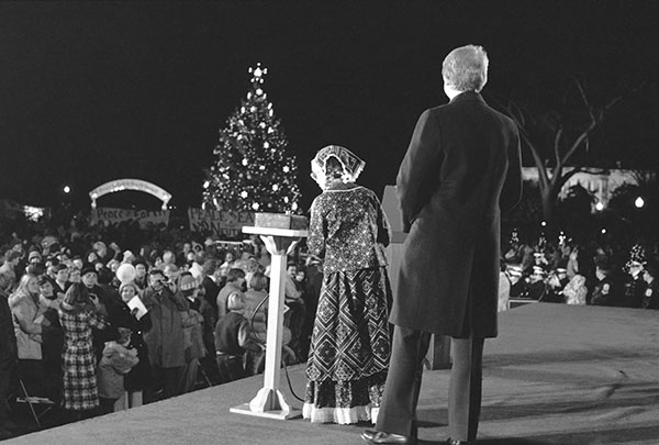 <div class='meta'><div class='origin-logo' data-origin='none'></div><span class='caption-text' data-credit='AP Photo'>Amy Carter stands with President Jimmy Carter on a stage at the Ellipse in Washington Thursday, Dec. 16, 1977, after he pushed a button illuminating the National Christmas Tree.</span></div>