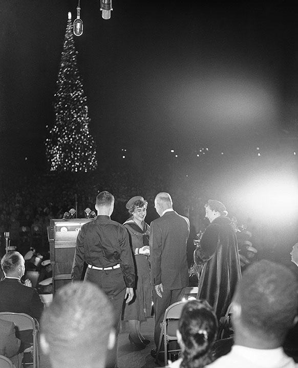 "<div class=""meta image-caption""><div class=""origin-logo origin-image none""><span>none</span></div><span class=""caption-text"">President Dwight Eisenhower shakes hands with Elizabeth Lamphere, 17-year-old girl scout, after lighting the National Christmas Tree on Dec. 23, 1958. (Bob Schutz/AP Photo)</span></div>"