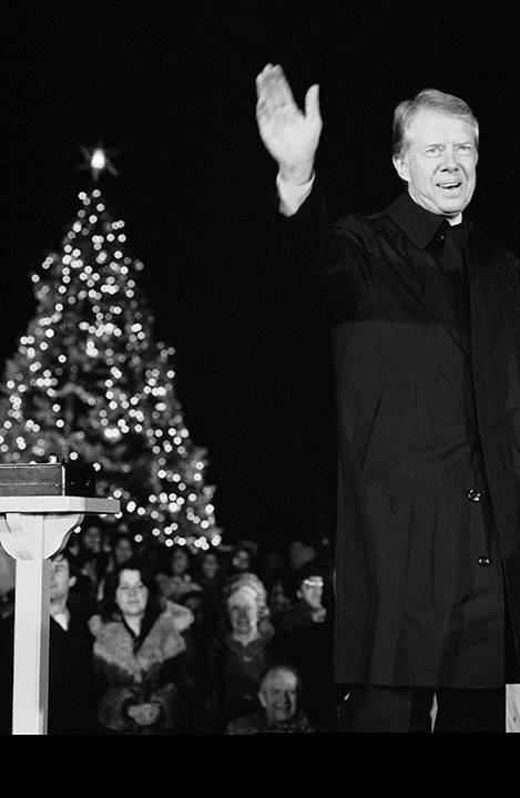 <div class='meta'><div class='origin-logo' data-origin='none'></div><span class='caption-text' data-credit='Ira Schwarz/AP Photo'>President Jimmy Carter waves after he and his daughter Amy pressed the button that turned on the lights of the National Christmas Tree on Dec. 15, 1978.</span></div>