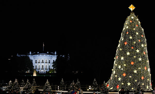 <div class='meta'><div class='origin-logo' data-origin='none'></div><span class='caption-text' data-credit='Haraz N. Ghanbari/AP Photo'>The White House is seen in the background after the lighting of the National Christmas Tree, Thursday, Dec. 3, 2009, in Washington.</span></div>