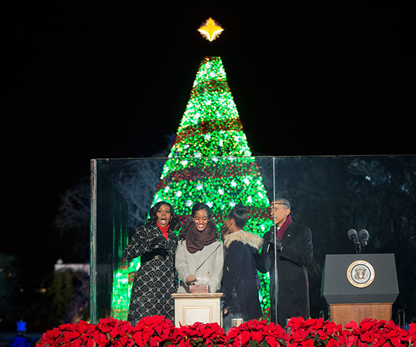 <div class='meta'><div class='origin-logo' data-origin='none'></div><span class='caption-text' data-credit='Pablo Martinez Monsivais/AP Photo'>President Barack Obama, right, with, first lady Michelle Obama, left, and daughters Malia and Sasha, participate in the National Christmas Tree lighting ceremony on Dec. 4, 2014.</span></div>