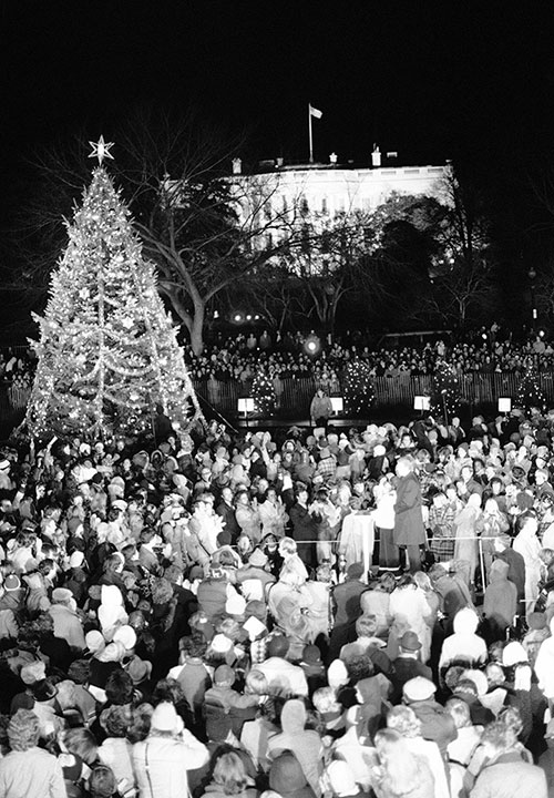 "<div class=""meta image-caption""><div class=""origin-logo origin-image none""><span>none</span></div><span class=""caption-text"">The National Christmas Tree is shown being lighted by President Jimmy Carter and daughter Amy on the Ellipse in Washington on Tuesday, Dec. 14, 1978. (Mark Wilson/AP Photo)</span></div>"