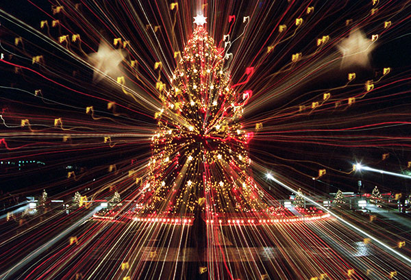 <div class='meta'><div class='origin-logo' data-origin='none'></div><span class='caption-text' data-credit='Mark Wilson/AP Photo'>The National Christmas Tree shines brightly Thursday, Dec. 7, 1995 on the Ellipse in Washington. A zoom lens technique was used to produce this photograph.</span></div>