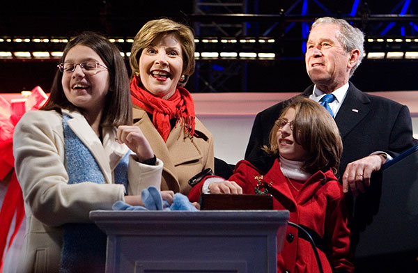 <div class='meta'><div class='origin-logo' data-origin='none'></div><span class='caption-text' data-credit='Haraz N. Ghanbari/AP Photo'>President George W. Bush and first lady Laura Bush are joined by Lindsey Van Horn, left, and Kayleigh Kepler, right, during the lighting ceremony on Dec. 4, 2008.</span></div>