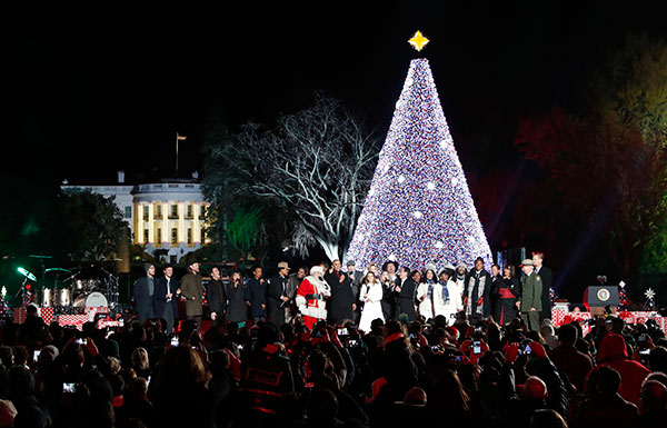 <div class='meta'><div class='origin-logo' data-origin='none'></div><span class='caption-text' data-credit='Alex Brandon/AP Photo'>President Barack Obama, with Michelle Obama, and daughter Sasha, sing with Santa Claus and others during the lighting ceremony for the 2016 National Christmas Tree.</span></div>