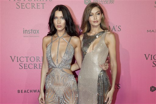 """<div class=""""meta image-caption""""><div class=""""origin-logo origin-image ap""""><span>AP</span></div><span class=""""caption-text"""">Models Bella Hadid, left, and Gigi Hadid pose during the after party photocall after the Victoria's Secret fashion show in Paris.  (AP Photo/Thibault Camus) (AP)</span></div>"""