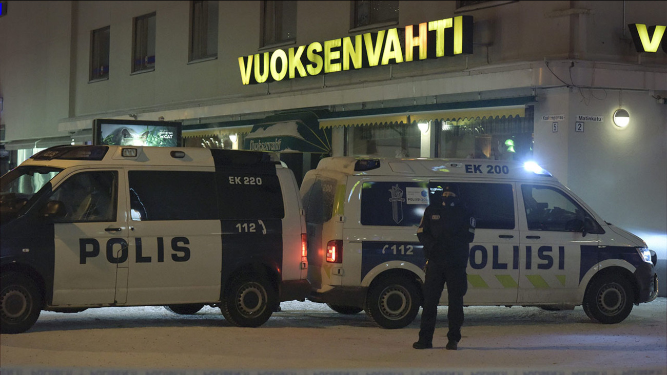 Police guard the area where three women were killed in a shooting incident outside of a restaurant in Imatra, Finland after midnight, Sunday, Dec. 4, 2016.