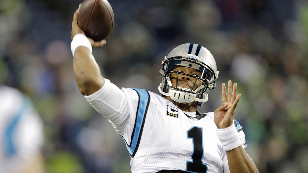 Carolina Panthers quarterback Cam Newton throws before an NFL football game against the Seattle Seahawks, Sunday, Dec. 4, 2016, in Seattle.