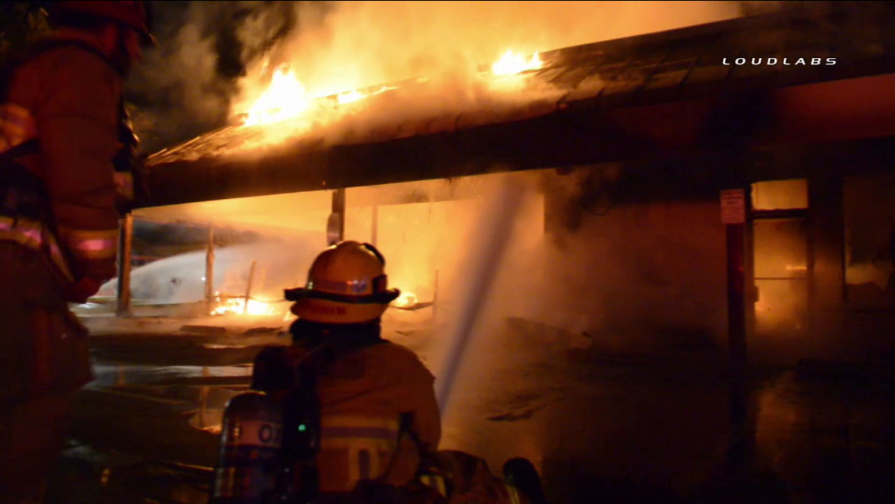 Flames ripped through a furniture store at an Oxnard strip mall on Sunday, Dec. 4, 2016.
