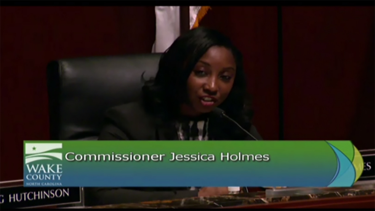 Jessica Holmes stunned fellow commissioners with her surprise announcement Monday.