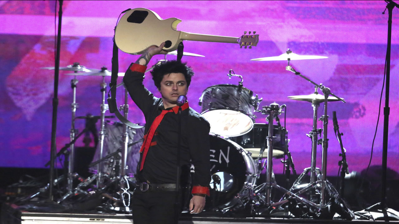 "Billie Joe Armstrong, of Green Day, performs ""Bang Bang"" at the American Music Awards at the Microsoft Theater on Sunday, Nov. 20, 2016, in Los Angeles."