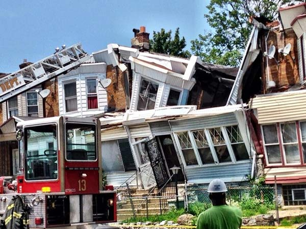 """<div class=""""meta image-caption""""><div class=""""origin-logo origin-image """"><span></span></div><span class=""""caption-text"""">Action News reporter Walter Perez took this photo of the scene of a house collapse in the Cobbs Creek section of Philadelphia on July 7, 2014.</span></div>"""