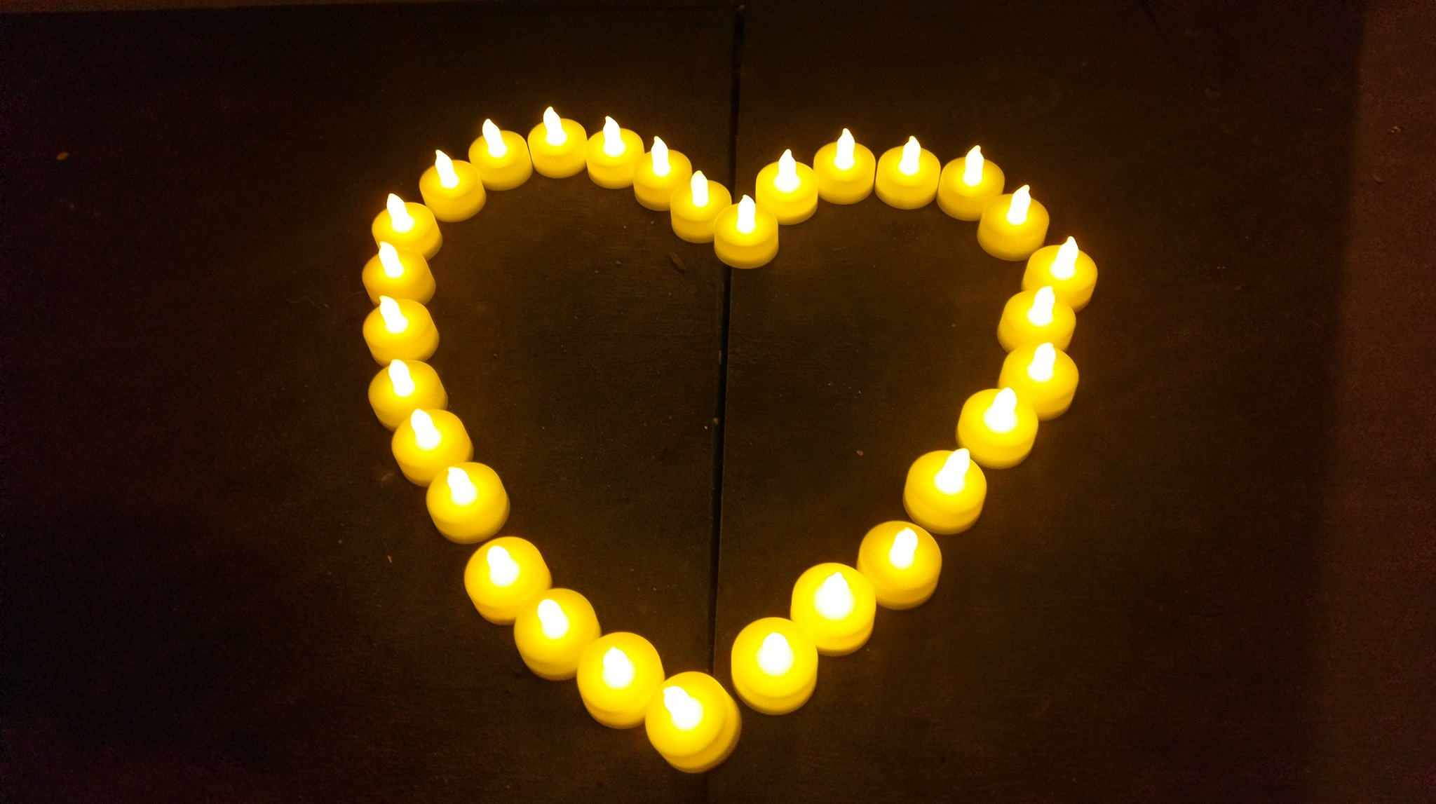 <div class='meta'><div class='origin-logo' data-origin='none'></div><span class='caption-text' data-credit='Kate Eby'>Candles in a heart shape appear at a vigil held for the victims of the Ghost Ship Fire at Lake Merritt in Oakland on Dec. 5, 2016.</span></div>