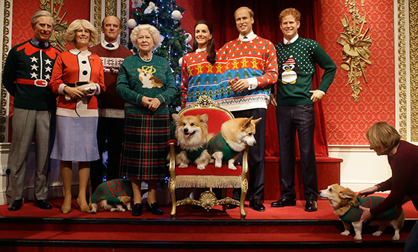 <div class='meta'><div class='origin-logo' data-origin='none'></div><span class='caption-text' data-credit='Alastair Grant/AP Photo'>Two Welsh Pembrokeshire Corgi dogs sit on a chair in front of wax work models of the British Royal family wear colorful Christmas themed jumpers for a charity campaign.</span></div>