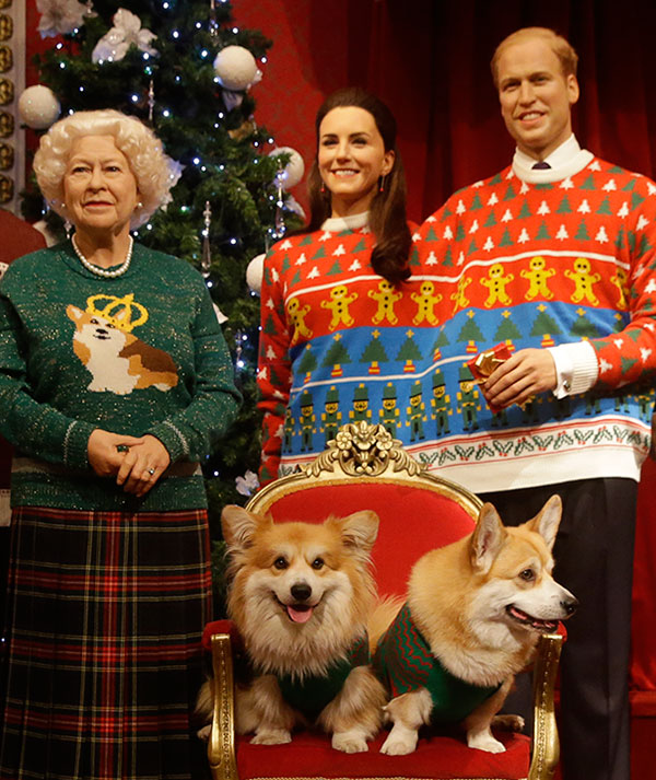 <div class='meta'><div class='origin-logo' data-origin='none'></div><span class='caption-text' data-credit='Alastair Grant/AP Photo'>Welsh Pembrokeshire Corgi pose with wax models of the British Royal family wearing colorful Christmas themed jumpers for a charity campaign.</span></div>