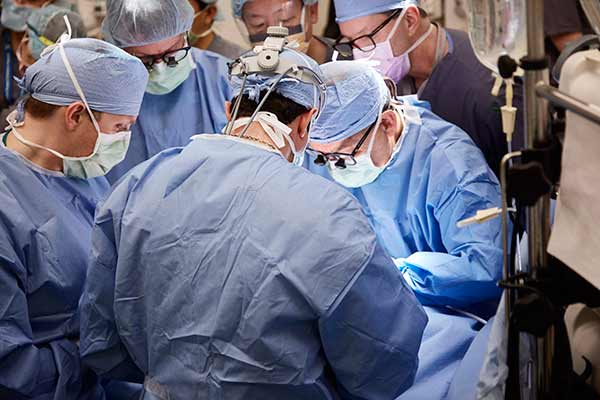 """<div class=""""meta image-caption""""><div class=""""origin-logo origin-image none""""><span>none</span></div><span class=""""caption-text"""">Surgery begins to separate 2-year-old conjoined twins Eva and Erika Sandoval. Surgeons pictured include lead surgeon Gary Hartman, MD; plastic and reconstructive surgeon H. Peter L (David Hodges/Lucile Packard Children's Hospital Stanford)</span></div>"""