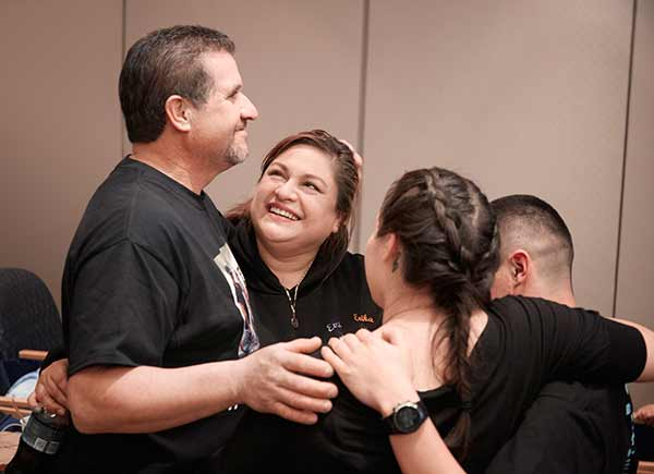 """<div class=""""meta image-caption""""><div class=""""origin-logo origin-image none""""><span>none</span></div><span class=""""caption-text"""">The twins' parents Arturo and Aida Sandoval embraced their older children, Esmeralda and Emilio, upon hearing the news that their twins had been successfully separated around 4:30 (David Hodges/Lucile Packard Children's Hospital Stanford)</span></div>"""