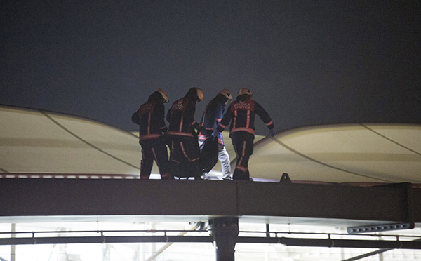 <div class='meta'><div class='origin-logo' data-origin='AP'></div><span class='caption-text' data-credit='AP'>Firefighters carry a dead body through the roof of stadium at the scene of explosions near the Besiktas football club stadium after attacks in Istanbul.</span></div>