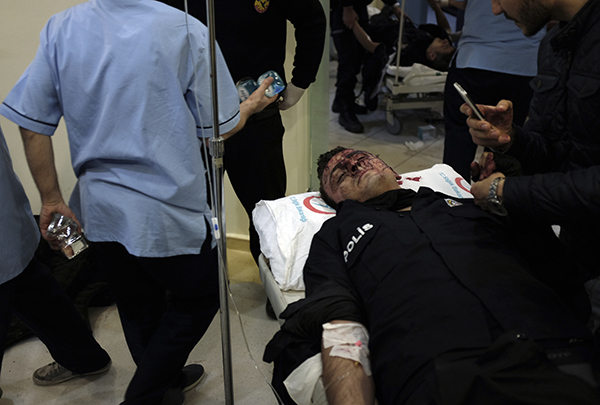 <div class='meta'><div class='origin-logo' data-origin='AP'></div><span class='caption-text' data-credit='AP'>A wounded police officer is taken into a nearby hospital after he was attacked at the scene of explosions near the Besiktas football club stadium after attacks in Istanbul.</span></div>