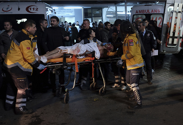 <div class='meta'><div class='origin-logo' data-origin='AP'></div><span class='caption-text' data-credit='AP'>Rescue and medics carry a wounded person after attacks in Istanbul, late Saturday, Dec. 10, 2016.</span></div>