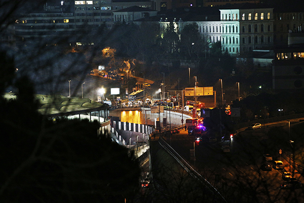 <div class='meta'><div class='origin-logo' data-origin='AP'></div><span class='caption-text' data-credit='AP'>As seen from a distance, rescue services work at the scene of explosions next to the Besiktas football club stadium.</span></div>
