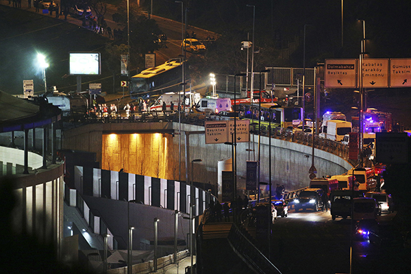 <div class='meta'><div class='origin-logo' data-origin='AP'></div><span class='caption-text' data-credit='AP'>As seen from a distance, rescue services work at the scene of explosions next to the Besiktas football club stadium, partially seen on the left, in Istanbul, late Saturday.</span></div>