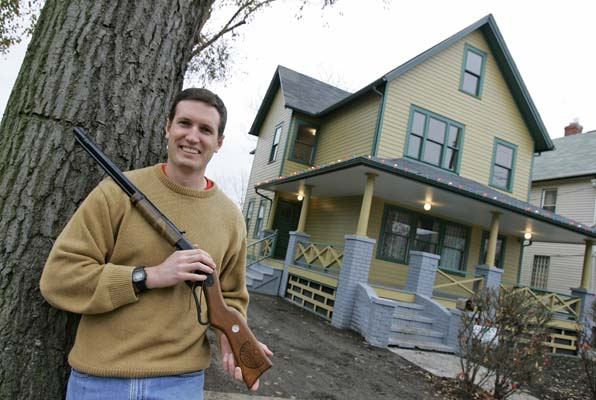 <div class='meta'><div class='origin-logo' data-origin='none'></div><span class='caption-text' data-credit='ASSOCIATED PRESS'>Brian Jones poses with his Red Ryder air rifle outside the renovated home which was used in the classic movie 'A Christmas Story' in Cleveland. (AP Photo/Amy Sancetta)</span></div>