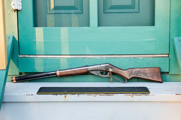 <div class='meta'><div class='origin-logo' data-origin='none'></div><span class='caption-text' data-credit='AP Images for A Christmas Story'>The Red Ryder BB Gun used in the movie sits on the back steps of A Christmas Story House and Museum in Cleveland. (Jason Miller/AP Images)</span></div>