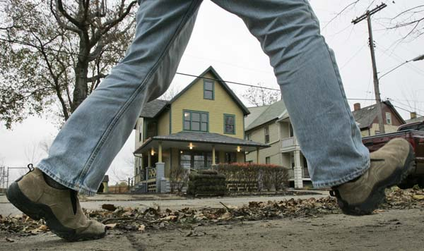 <div class='meta'><div class='origin-logo' data-origin='none'></div><span class='caption-text' data-credit='ASSOCIATED PRESS'>In this  Nov. 13, 2006 file photo, a pedestrian passes by the home used in the classic film 'A Christmas Story' in Cleveland. (AP Photo/Amy Sancetta, File)</span></div>