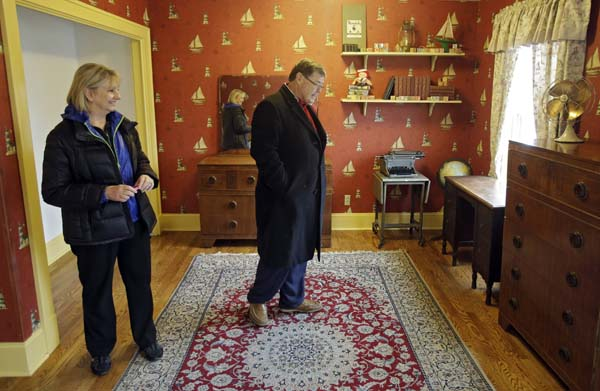 <div class='meta'><div class='origin-logo' data-origin='none'></div><span class='caption-text' data-credit='AP'>Judy and Michael Paulson, from Plano, Texas, view Ralphie's room in the Cleveland house where the 1983 movie &#34;A Christmas Story&#34; was filmed. (AP Photo/Mark Duncan)</span></div>