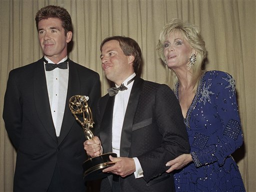 <div class='meta'><div class='origin-logo' data-origin='AP'></div><span class='caption-text' data-credit='AP Photo/Mark Lennihan'>Alan Thicke, left, and Joan Van Ark, right, present Bob Costas, center, with the Sports Emmy for Outstanding Personality/Host in New York in night on Wednesday, July, 14, 1988.</span></div>