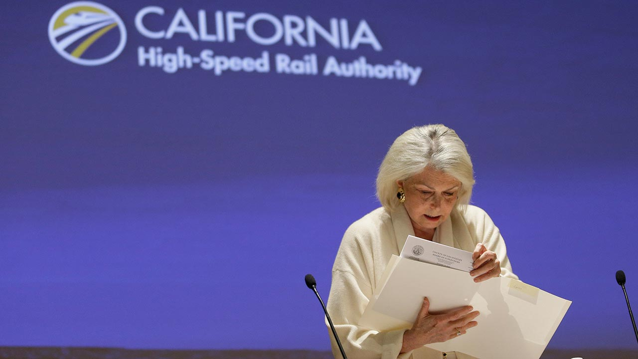 Lynn Schenk, a member of the California High Speed Rail Authority Board, looks over papers before the board meeting Tuesday, Dec. 13, 2016, in Sacramento, Calif.