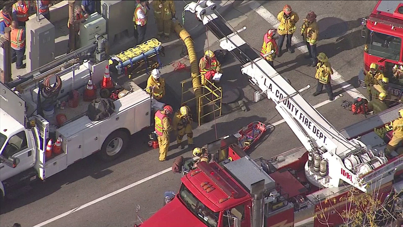 Firefighters responded after a person fell 15 feet into an underground vault and became trapped under a street in La Habra on Wednesday, Dec. 14, 2016.